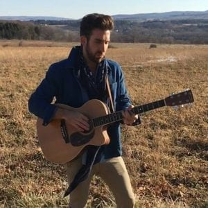 L Marco Johnson playing in a fall field
